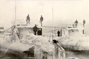 Fr. Edward J. Dowling, S.J. Marine Historical Collection: On the left hand side, loaded, covered in ice after a winter trip.