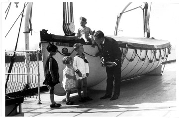 Fr. Edward J. Dowling, S.J. Marine Historical Collection: Keewatin - Lifeboat, officers, and children, 1920s.