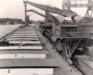 Fr. Edward J. Dowling, S.J. Marine Historical Collection: Williiam G. Mather - Hulett ore unloaders working on the Mather, 1950s.