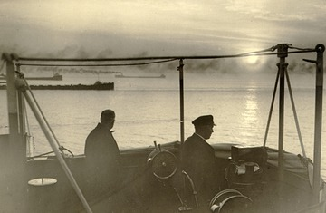 Keewatin - View from open bridge, ore carriers off to port, equipment visible, canvas cover for bridge also visible.