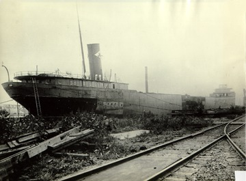 William C. Moreland 1916 rebuilding with new bow and mid-body, stern not yet refurbished with J & L logo still on stack.