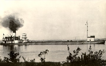 Starboard side view, fully loaded, in the St. Mary's River (between Lake Superior and Lake Huron). Note detached pilothouse, c.1905.